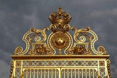 VERSAILLES, FRANCE - August 8, 2015: Main golden gates of the chateau de Versailles, Versailles, France. Stock Image