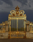 VERSAILLES, FRANCE - August 8, 2015: Main golden gates of the chateau de Versailles, Versailles, France. Royalty Free Stock Photos