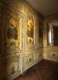 Versailles, France - 10 August 2014 : Mirror and painted wooden wall at Versailles Palace. ( Chateau de Versailles ). It was added to the UNESCO list of World royalty free stock photo