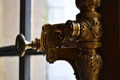 Versailles / France - January 05 2012: Beautiful handle opening the window frame. stock images