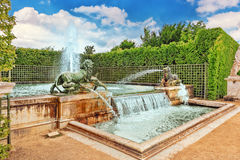 VERSAILLES, FRANCE- JULY 02, 2016 :Fountain with lions in a beau. Tful and Famous Gardens of Versailles (Chateau de Versailles royalty free stock photography