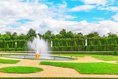 VERSAILLES,  FRANCE- JULY 02, 2016 : Fountain near the flower be Stock Images