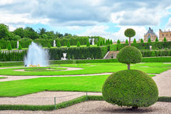 VERSAILLES, FRANCE- JULY 02, 2016 : Fountain near the flower bed Royalty Free Stock Image