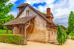 VERSAILLES, FRANCE - JULY 02, 2016 : Landscape of hamlet Queen M. VERSAILLES, FRANCE - JULY 02, 2016 :Landscape of hamlet Queen Marie Antoinette`s estate near Stock Image