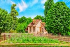 VERSAILLES, FRANCE - JULY 02, 2016 : Landscape of hamlet Queen M. Arie Antoinette`s estate near Versailles Palace. Palace Versailles -most beautiful palace in Royalty Free Stock Photo