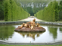 Versailles gardens. Statuary fountain in the gardens of Palace of Versailles, France - royal residence of Louis XIV Royalty Free Stock Photo