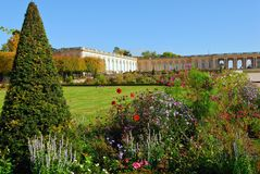 Versailles gardens-Trianon. Blooming colorful flowerbeds in Versailles gardens, France royalty free stock photography