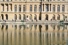 Versailles Palace in France. Building with it's shadow in the water Royalty Free Stock Images