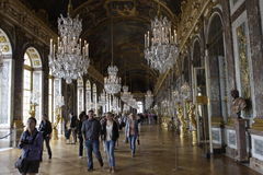 Versailles Palace Mirror Hall. Tourists in Versailles Palace. Mirror Hall Stock Photo