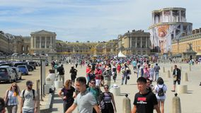 Versailles, PARIS, FRANCE- August 2018: a lot of multiracial tourists in the square in front of the royal palace. Black stock video footage