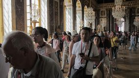 Versailles, Paris, France- August 2018: a lot of tourists with audio guides in the main hall of the royal palace. Luxurious interior of the royal palace stock video footage