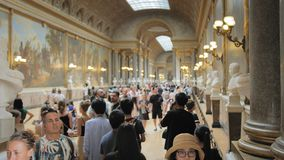Versailles, Paris, France- August 2018: a lot of tourists in the main hall of the royal palace. Luxurious interior of. The royal palace. a lot of busts of stock footage