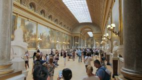 Versailles, Paris, France - August 2018: A lot of tourists take pictures and see the sights in the main hall of the royal stock video footage