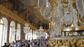 Versailles, Paris, France- August 2018: Luxurious interior of the royal palace. Crystal chandelier in the foreground stock video footage