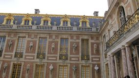 Versailles, Paris, France - August 2018: Rich decoration, luxury and balconies and stucco on the facade, marble rooms of stock footage