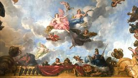 VERSAILLES, PARIS, FRANCE- SEPTEMBER 23, 2015: shot of a ceiling painting in the palace of versailles. Paris france royalty free stock photos