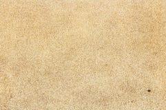 Versanden Sie Draufsicht der Beschaffenheit über den tropischen Strand mit sichtbarem Sand te Lizenzfreies Stockfoto