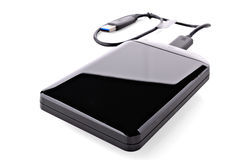 Versatile Hard Drive. With USB cable on white background Royalty Free Stock Image