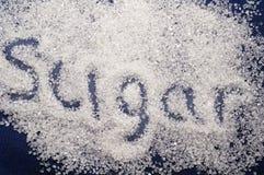 Verschütten des Zuckers Stockfoto