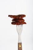Verscheidene droge die tomaten op vork worden gespietst Royalty-vrije Stock Fotografie