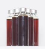 Verscheidene flessen vloeibare geneeskunde Royalty-vrije Stock Foto