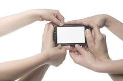 Verscheidene handen die een telefoon houden Stock Foto's