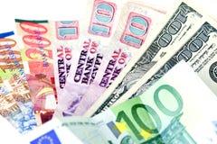 Verscheidene landenmunten (nadruk op dollars) Stock Afbeeldingen