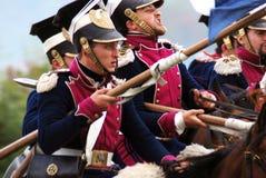 Verscheidene militairen berijden paarden. Royalty-vrije Stock Afbeelding