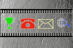Verscheidene symbolen worden afgeschilderd op filmimitatie stock afbeeldingen