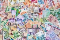 Verscheidenheid van globale bankbiljetten, geldinzameling, munten royalty-vrije stock afbeelding