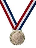 Verschieden.: Glänzende Goldmedaille mit rotem weißem u. grünem Farbband Stockfotografie