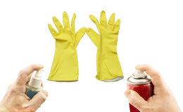 Verschiedene Aerosole in der Hand und gelbe Handschuhe Stockfotografie