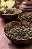 Verschiedene Arten des grünen Tees Stockfotos