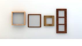 Verschiedene Arten von leeren Rahmen auf einer weißen Wand Lizenzfreie Stockbilder