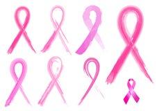 7 verschiedene Brustkrebsbänder in den Bürstenanschlägen Lizenzfreie Stockfotos