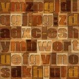 Verschiedene Buchstaben auf Hintergrund Hölzernes Muster lizenzfreie abbildung