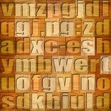 Verschiedene Buchstaben auf Hintergrund Kirschhölzernes Muster lizenzfreie abbildung