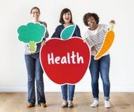Verschiedene Frauen mit Gesundheitsikonen Stockfotografie