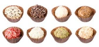 Verschiedene geschmackvolle handgemachte Süßigkeiten getrennt auf Weiß Lizenzfreie Stockfotografie