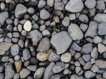 Verschiedene Größe von grauen Steinen Draufsicht des grauen Steinbodens Lizenzfreies Stockbild