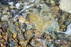 Verschiedene graue Steine, Wellen, abstrakter Hintergrund Stockbilder