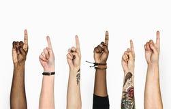 Verschiedene Hände, die oben Finger zeigen Lizenzfreies Stockbild