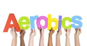 Verschiedene Hände, die Wort-Aerobic halten Stockfoto