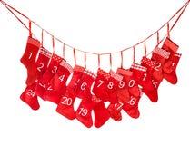 Verschiedene Karikaturweihnachtsikonen und -elemente Rote Weihnachtsstrumpfdekoration Stockbild