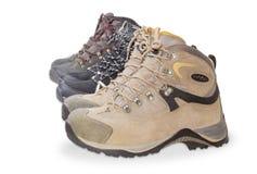 Verschiedene Stiefel für Trekking auf einem weißen Hintergrund Lizenzfreies Stockfoto