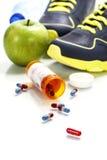 Verschiedene Werkzeuge für Sport und Pillen Stockfoto