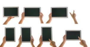Verschiedener Tablet-Computer lokalisiert in einer Hand auf dem weißen backgrou Stockbilder