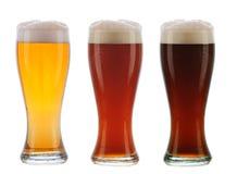 Verschillend bier drie in Galsses met Schuimende Bovenkanten Royalty-vrije Stock Foto's
