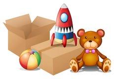 Verschillend speelgoed met twee dozen Stock Afbeeldingen