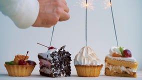 Verschillende cupcakes met sterretjes Idee voor vakantie, verjaardagen, verjaardagen, vieringen en partijen stock videobeelden
